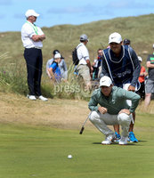 2018 Dubai Duty Free Irish Open - Day 1, Ballyliffin Golf Club, Co. Donegal 5/7/2018. Rory McIlroy with caddy Harry Diamond on the fourth green. Mandatory Credit ©INPHO/Oisin Keniry