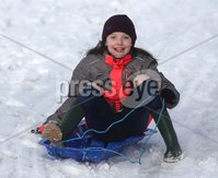 ©Lorcan Doherty February 12th 2018. Isabel Nelis (10), from Creggan, enjoying the Mid Term Break snow Fall in Brooke Park, Derry.