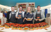 Press Eye - Belfast - Northern Ireland - 16th May 2018. First day of the 2018 Balmoral Show, in partnership with Ulster Bank, at Balmoral Park.  Wolf and Woodsman\'s David Knowles, Andy Laverty and Jonny Laverty with Lynsey Cunningham Regional Director, Entrepreneurship at Ulster Bank. Wolf and Woodsman was one of the companies provided with free space by Ulster Bank to exhibit in its marquee. The companies include Ulster Bank customers and entrepreneurs from the bank\'s Entrepreneur Accelerator.. Picture by Jonathan Porter/PressEye