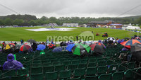 Mandatory Credit: Rowland White/Presseye. Cricket: One Day International. Teams: Ireland (green) v Australia (yellow). Venue: Stormont:. Date: 23rd June 2012. Caption:  Brollys, empty seats,covers and tractors