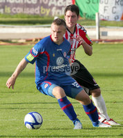 Airtricity League Premier Division, The Brandywell 13/7/2012. Derry City vs Sligo Rovers. Derry\'s Ruairdhi Higgins with David Cawley of Sligo Rovers.. Mandatory Credit ©INPHO/Margaret McLaughlin