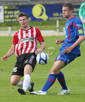 Airtricity League Premier Division, The Brandywell 13/7/2012. Derry City vs Sligo Rovers. Derry\'s Conor Murphy with Jason McGuinness of Sligo Rovers. Mandatory Credit ©INPHO/Margaret McLaughlin