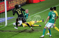 Press Eye - Belfast, Northern Ireland - 18th November 2020 - Photo by William Cherry/Presseye. Northern Ireland\'s Liam Boyce scoring past Romania goalkeeper Ciprian Tatarusanu during Wednesday nights UEFA Nations League game at the National Football Stadium at Windsor Park, Belfast. Photo by William Cherry/Presseye
