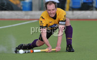 Mandatory Credit: Rowland White/Presseye. Men\'s Hockey: Irish Senior Cup Semi-Final. Teams: Cork Harlequins (black) v Instonians (yellow). Venue: National Hockey Stadium, Dublin. Date: 12th May 2012. Caption: Stephen Redpath, Instonians