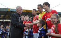Presseye Northern Ireland - 15th May 2012 Mandatory Credit - Photo-William Cherry/Presseye. Harry Gregg Testimonial - Irish League XI v Manchester United. Manchester United legend Harry Gregg  shakes hands with Jonny Evans before his emotional Testimonial at Windsor Park.
