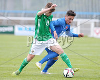 Press Eye Belfast - Northern Ireland 7th September 2018. U19 International Challenge Match - Northern Ireland Vs Slovakia at The Showgrounds, Newry.. Northern Ireland\'s Caoimhin McConnell with Slovakia\'s Mario Strachen.. Picture by Jonathan Porter/PressEye.com