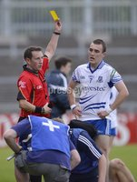 Press Eye - Belfast - Northern Ireland - 5th August 2012. GAA Football All Ireland Minor Championship Quarter-Final : Dublin vs Monaghan at Pairc Esler, Newry. Monaghans Padraic Keenan gets a yellow card from Referee Derek O\'Mahoney at Saturdays Q-Final. ©Russell Pritchard / Presseye