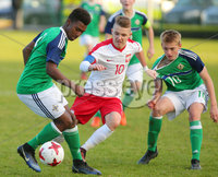 Press Eye Belfast - Northern Ireland 28th November 2017. School boys International - Northern Ireland Vs Poland at the Dub in south Belfast. . Northern Ireland\'s Alberto Balde(left) and Ben Wylie with Poland\'s Michal Rakocry.. . Picture by Jonathan Porter/PressEye.com