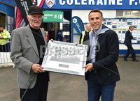 Saturday 21st  July 2018. Supercup NI match between Celtic u19\'s and Manchester United u19\'s at Coleraine Showgrounds..  Manchester United legend Phil Neville pictured at tonights game presenting Harry Gregg. Mandatory Credit: Stephen Hamilton /Presseye