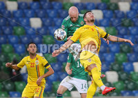 Press Eye - Belfast - Northern Ireland - 12th November 2020. UEFA Nations League 2021 - Northern Ireland Vs Romina at The National Stadium at Windsor Park, Belfast.. Northern Irelands Liam Boyce with Rominas Alin Toca. Picture by Jonathan Porter/PressEye