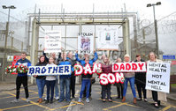 Press Eye - Belfast - Northern Ireland - 19th May 2019. Protest at the gates of Maghaberry Prison in Co. Down by families who have lost loved ones to suicide in prison. Paul McConville(centre back) lost his 22-year-old son Daniel in August 2018.  The father-of-two from Lurgan died while in custody. He had been due to appear in court charged with possession of cannabis resin the day after he died.. . Picture by Jonathan Porter/PressEye