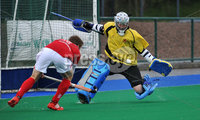 Mandatory Credit: Rowland White/Presseye. Hockey: Super 9\'s Finals. Teams: Dale Dragons (white) v Cookstown Maverics (red). Venue: Banbridge. Date: 25th April 2012. Caption: Johnny Moore saves for Dragons