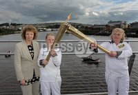Presseye Northern Ireland - 04th June 2012 Mandatory Credit - Photo-William Cherry/Presseye. Minister Carál Ní Chuilín has joined hundreds of local people to welcome the all-Ireland Olympic Torch relay across the Peace Bridge in Derry. The Minister is pictured with Torchbearers Meabh Fischer and Isabella Coote in the middle of the Peace Bridge.