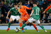 Press Eye - Belfast, Northern Ireland - 16th November 2019 - Photo by William Cherry/Presseye. Northern Ireland\'s Paddy McNair and Corry Evans with Netherlands\' Frenkie de Jong during Saturday nights UEFA Euro 2020 Qualifier at the National Stadium, Belfast.     Photo by William Cherry/Presseye