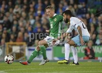 11th August 2018. International Friendly match between . Northern Ireland and Israel  at the national stadium in Belfast.. Northern Irelands Steven Davis  in action with Israels Ben Bitton.  Mandatory Credit: Stephen Hamilton /Presseye