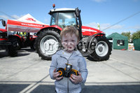PressEye-Northern Ireland- 16th May 2018-Picture by Brian Little/ PressEye. Max Jess aged 3 from Kilkeel looking at the tractors  during the First day of the 2018 Balmoral Show, in partnership with Ulster Bank, at Balmoral Park. Picture by Brian Little/PressEye