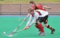 Mandatory Credit: Rowland White/Presseye. Hockey: Super 9\'s Finals. Teams: Banbridge Bears (red) v Dale Dragons (white). Venue: Banbridge. Date: 25th April 2012. Caption: Fraser Mills, Dale and Hugh McShane, Bears