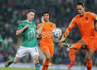 Press Eye - Belfast - Northern Ireland - 16th November 2019. UEFA EURO 2020 Qualifier Group C.  Northern Ireland Vs Netherlands at the National Stadium at Windsor Park, Belfast. . Northern Irelands Gavin Whyte with Netherlands Virgil van Dijk. . Picture by Jonathan Porter/PressEye