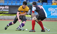 Mandatory Credit: Rowland White/Presseye. Men\'s Hockey: Irish Senior Cup Semi-Final. Teams: Cork Harlequins (black) v Instonians (yellow). Venue: National Hockey Stadium, Dublin. Date: 12th May 2012. Caption: James Corry, Instonians and Mark Black, Cork