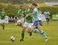 Press Eye - Belfast - Northern Ireland - 8th June. World Cup qualifier - Northern Ireland  v Netherlands at Shamrock Park Portadown.. Northern Irelands Julie Nelson  in action with Netherlands  Ellen Jansen. Mandatory Credit: Presseye/Stephen Hamilton
