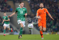 Press Eye - Belfast - Northern Ireland - 16th November 2019. UEFA EURO 2020 Qualifier Group C.  Northern Ireland Vs Netherlands at the National Stadium at Windsor Park, Belfast. . Northern Irelands Gavin Whyte with Netherlands Daley Blind.. . Picture by Jonathan Porter/PressEye