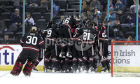 Press Eye - Belfast, Northern Ireland - 30th November 2019 - Photo by William Cherry/Presseye.  Northeastern Huskies players celebrate after defeating Colgate Raiders to lift the prestigious Belpot trophy during Saturday evenings Friendship Four Championship game at the SSE Arena, Belfast.    Photo by William Cherry/Presseye