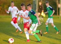 Press Eye Belfast - Northern Ireland 28th November 2017. School boys International - Northern Ireland Vs Poland at the Dub in south Belfast. . Northern Ireland\'s Ben Wylie with Poland\'s Arkadiusz Baran. Picture by Jonathan Porter/PressEye.com