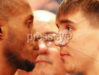 Press Eye - Belfast - Northern Ireland - 29th June 2018. Weigh in at the Europa Hotel in Belfast ahead of Michael Conlan\'s homecoming fight against Brazilian Adeilson Dos Santos at the SSE Arena on Saturday night. . Left to right.  Adeilson Dos Santos and Michael Conlan go head-to-head after the weigh in. . Picture by Jonathan Porter/PressEye