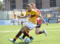 Press Eye - Belfast - Northern Ireland - 30th June 2018. Jordan Owens testimonial match between Crusaders and Motherwell at Seaview Belfast.. Crusaders Michael Carvill in action with Motherwells Ryan Bowman. Mandatory Credit: Presseye/Stephen Hamilton