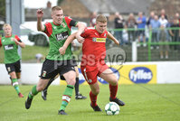4th August 2018. Danske Bank Irish premier league match between Glentoran and Cliftonville at The Oval in Belfast.. Glentorans Calum Birney  in action with Cliftonvilles Levi Ives.  Mandatory Credit: Stephen Hamilton /Inpho