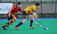 Mandatory Credit: Rowland White/Presseye. Men\'s Hockey: Irish Hockey League. Teams: Banbridge (red) v Instonians (yellow). Venue: Banbridge. Date: 14th April 2012. Caption: John Watson, Instonians and Matthew Bell, Banbridge
