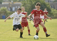 26th  July 2018. SuperCupNI 2018 Minor  section semi final between Greenisland and Portadown at Seahaven Portstewart.. Greenisland\'s Ben Andrews  in action with Portadowns Johnny McCullough.  Mandatory Credit: Stephen Hamilton /Presseye