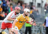Ulster GAA Senior Hurling Championship Final - Antrim v Derry - 8th July 2012. Copyright Presseye.com. Mandatory Credit Declan Roughan / Presseye. Antrim\'s Aaron Graffin and Derry\'s Kevin Hinphey