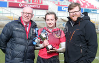 Press Eye Belfast - Northern Ireland 14th March 2019. Danske Bank Ulster Schools Girls X7s Senior Cup Final. Enniskillen Royal Grammar School(in red) vs Loreto Secondary School Letterkenny.. Enniskillen\'s captain Katie Hetherington lift\'s the cup after winning the final and is pictured with Ulster Rugby President Stephen Elliott(left) and Danske Bank Bloomfield Bangor Branch manager Nick Craig. . . Picture by Jonathan Porter/PressEye.com