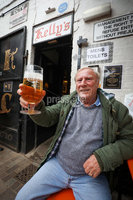 Press Eye - Belfast - Northern Ireland - 10th October 2020. New coronavirus restrictions come into force on Friday evening.. Punters make the most of the last few hours. . Geard McCullagh toasts his last pint.. Picture by Matt Mackey / Presseye.
