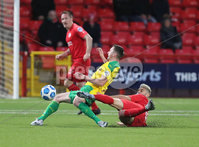 Danske Bank Premiership, Inver Park, Co. Antrim, Northern Ireland 21/11/2020. Larne vs Cliftonville. Larne David McDaid  yellow card tackle against  Cliftonville Ronan Doherty    during Saturday\'s  Danske Bank Premiership match at Inver Park, Larne.. Mandatory Credit INPHO/Presseye/Brian Little