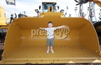 PressEye-Northern Ireland- 15th May  2019-Picture by Brian Little/PressEye. Kieran Loughran aged 4 from Dungannon in the shovel of a CAT Wheel Loader , 18,849 kg,  at Balmoral Park during the first day of the Balmoral Show 2019. Picture by Brian Little/PressEye