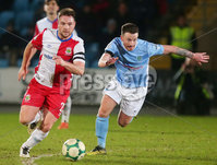 Tenants Country Antrim Shield Semi Final at Ballymena Showgrounds.  08.01.2019. Ballymena United v Linfield FC. Ballymena\'s William Faulkner with Linfield\'s Jamie Mulgrew. Mandatory CreditINPHO/PressEye.com/Jonathan Porter.