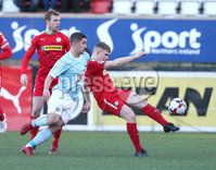 Press Eye - Belfast - 6th January 2018  . Cliftonville v Warrenpiont Town, Tennents Irish Cup 5th round at Solitude, North Belfast.. Cliftonville\'s Levi Ives in action with Warrenpiont Town\'s Seanna Foster. Picture by Matt Mackey / Inpho.ie