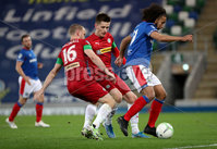 Press Eye - Belfast, Northern Ireland - 29th October 2019 - Photo by William Cherry/Presseye. Linfield\'s Bastien Hery with Cliftonville\'s Liam Bagnall and Ryan Curran during Tuesday nights BetMcLean League Cup game at Windsor Park, Belfast.     Photo by William Cherry/Presseye