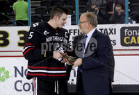 Press Eye - Belfast, Northern Ireland - 30th November 2019 - Photo by William Cherry/Presseye. Eric Porter, Chairman Odyssey Trust presents Northeastern Huskies captain Ryan Shea with the prestigious Belpot trophy after Saturday evenings Friendship Four Championship game against Colgate Raiders at the SSE Arena, Belfast.      Photo by William Cherry/Presseye