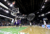 Press Eye - Belfast -  Northern Ireland - 01st December 2017 - Photo by William Cherry/Presseye. Manhattan College\'s Ebube Ebube and Zane Waterman with Holy Cross\'s Matt Faw during Friday afternoons Basketball Hall of Fame Belfast Classic game at the SSE Arena, Belfast.