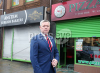 Press Eye - Belfast - Northern Ireland - 5th February 2019. The scene on Antrim\'s High Street where a newly open Turkish Barbers was gutted after an arson attack on Monday evening.  Firefighters tackled the blaze around 7.40pm on Monday night with police investigating the incident. . Mayor of Antrim and Newtownabbey Cllr Paul Michael pictured at the scene. . Picture by Jonathan Porter/PressEye