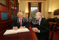 Press Eye - Belfast - Northern Ireland - 13th January 2020. British Prime Minister Boris Johnson visits Stormont in east Belfast after power sharing returned at the weekend to the Northern Ireland Assembly.. Prime Minister Boris Johnson is greeted by the Sinn Fein Speaker of the Assembly Alex Maskey at Parliament Buildings where he signs the visitors book in the Speakers Chamber. . Picture by Jonathan Porter/PressEye