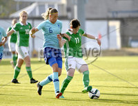 Press Eye - Belfast - Northern Ireland - 8th June. World Cup qualifier - Northern Ireland  v Netherlands at Shamrock Park Portadown.. Northern Irelands Kirsty McGuiness in action with Netherlands Anouk Dekker. Mandatory Credit: Presseye/Stephen Hamilton