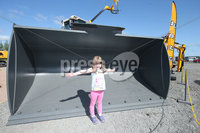 PressEye-Northern Ireland- 16th May 2018-Picture by Brian Little/ PressEye. Rebecca Kelly, aged 4, from Dungannon standing in the Shovel of a Liebherr Wheel Loader weighing 23,900 Kg on the  First day of the 2018 Balmoral Show, in partnership with Ulster Bank, at Balmoral Park. Picture by Brian Little/PressEye