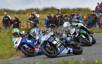 Mandatory Credit: Rowland White / PressEye. ULSTER GRAND PRIX. Venue: Dundrod. Date: 12th August 2017. Class: SUPERSPORT RACE. Caption: Paul Jordan (38), Derek McGee (86) and Adam McLean (86) well into it