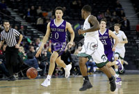 Press Eye - Belfast -  Northern Ireland - 01st December 2017 - Photo by William Cherry/Presseye. Manhattan College\'s Zavier Turner with Holy Cross\'s Caleb Green during Friday afternoons Basketball Hall of Fame Belfast Classic game at the SSE Arena, Belfast.