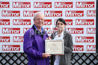 Press Eye - Belfast - Northern Ireland - 7th May 2018  - . May Day Meeting at Down Royal Racecourse.. DAILY MIRROR BEGINNERS CHASE. Caroline Todd from The Daily Mirror makes a presentation to winning owner of Peace News, Alan Coady.. Photo by Kelvin Boyes / Press Eye .