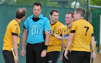 Mandatory Credit: Rowland White/Presseye. Men\'s Hockey: Irish Senior Cup Semi-Final. Teams: Cork Harlequins (black) v Instonians (yellow). Venue: National Hockey Stadium, Dublin. Date: 12th May 2012. Caption: Instonians make a protest